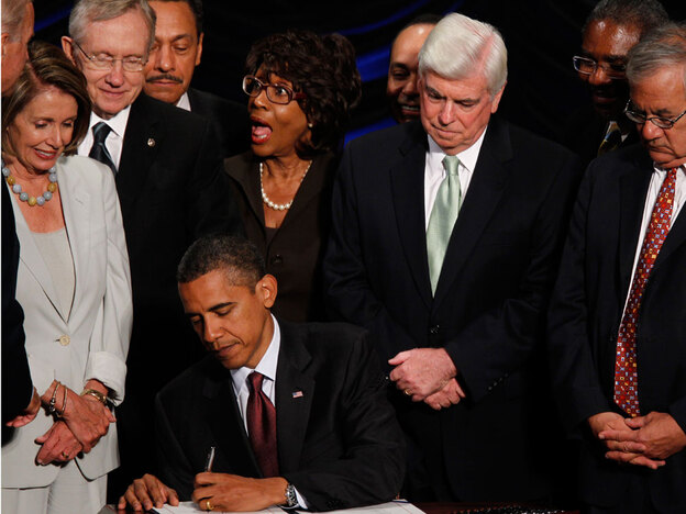 President Obama signs the financial overhaul bill in July. Because of this and other crackdowns, Wall Street donors feel like the social contract has been broken, according to Ross Baker, political scientist at Rutgers University.