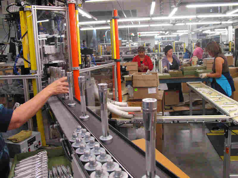 Workers assemble Maglites in the company's Ontario, Calif., factory.