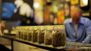 Jars full of medical marijuana are seen at Sunset Junction medical marijuana dispensary in Los Angeles in May.