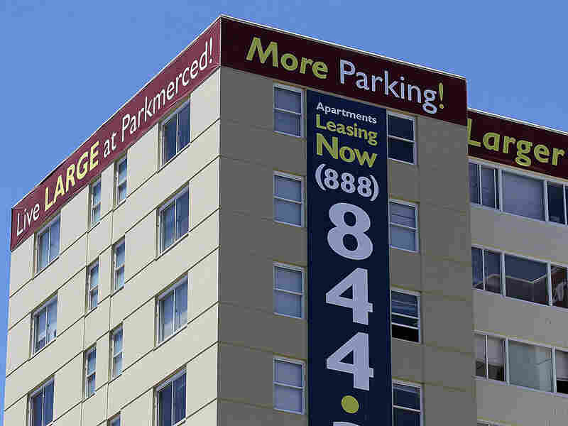A lease sign is posted on an apartment complex in San Francisco.