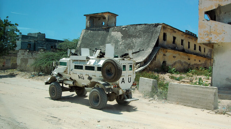 Africa Union peacekeepers race through the bombed-out city at up to 60 miles an  hour to avoid attack by Islamist insurgents.