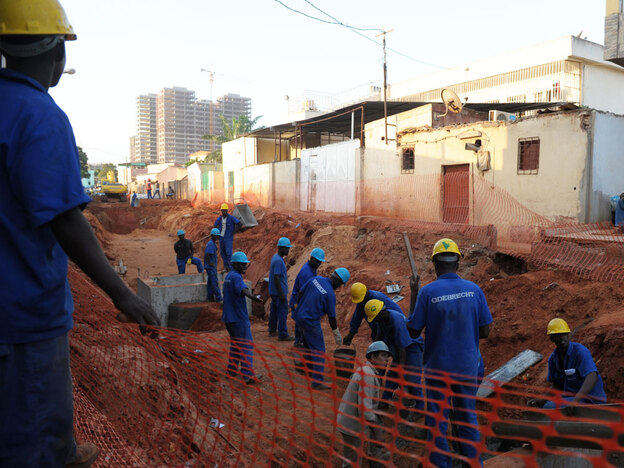 Laborers for Brazilian construction company Odebrecht work on a construction site in Luanda, Angola, in January 2010. Odebrecht is among the major Brazilian companies that are expanding the South American country's economic influence around the world.