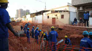 Workers for Brazilian company Odebrecht at a construction site in Angola