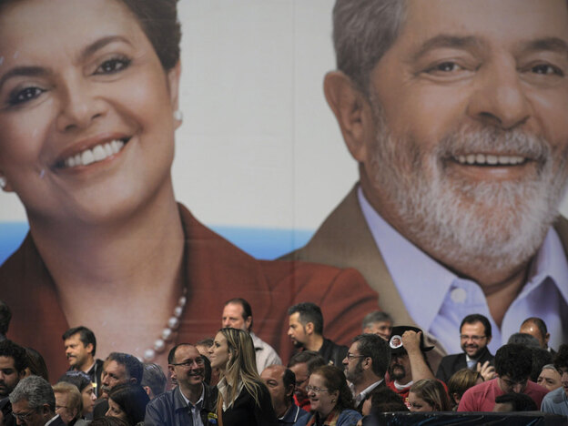 Polls show Rousseff is now 25 points ahead of her nearest rival, Jose Serra, a former governor. If elected, she would become Brazil's first female president. Here, crowds gather in front of a campaign poster in Sao Paulo.
