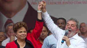 Brazil's President Luiz Inacio Lula da Silva, right, attends a campaign rally with Dilma Rousseff