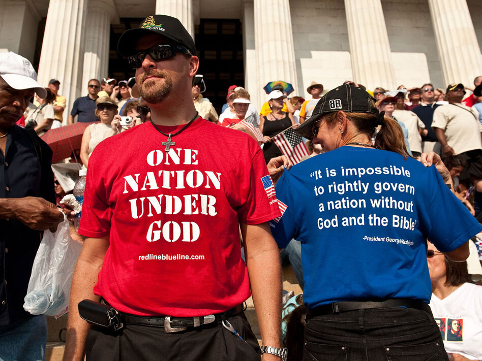 People gather at a rally in Washington, D.C., organized by conservative Fox News commentator Glenn Beck, one of the de facto leaders of the  Tea Party movement. While the Tea Party says it doesn't take a stance on religious and social issues, many of its supporters are conservative Christians. (Nicholas Kamm/AFP/Getty Images)