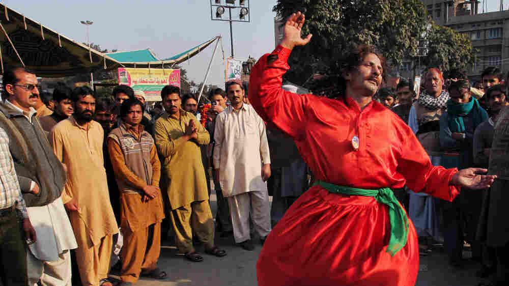A Pakistani Sufi Muslim dances in Lahore