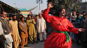 A Pakistani Sufi Muslim dances in Lahore