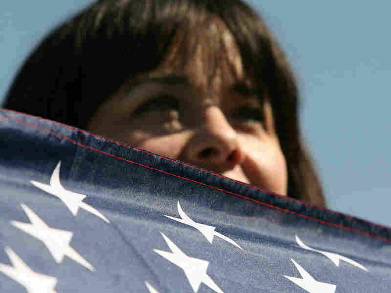 A person with an American flag participates in the One Nation March