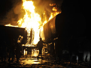 Firefighters battle oil tanker fire