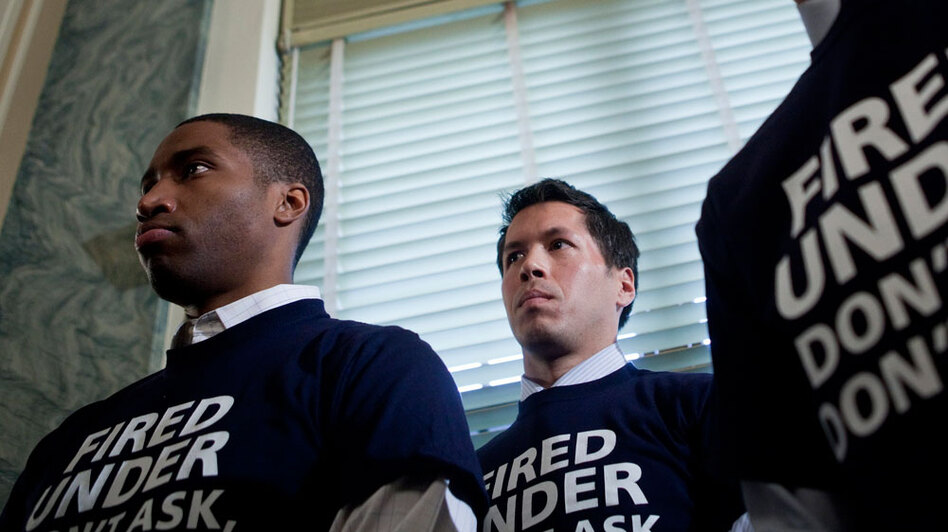 """Former service member Anthony Woods (left) listens during a news conference on Capitol Hill in Washington, D.C. Since his discharge from the U.S. Army, Woods ran for Congress in California, and now he collaborates with groups trying to repeal the U.S. military's """"don't ask, don't tell"""" policy that bans gays and lesbians from serving openly."""