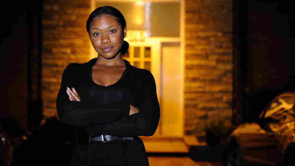Jada Irwin stands in front of her apartment building.