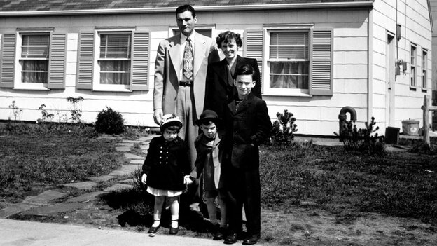 Truck supervisor Bernard Levey with his family in front of their home in the then-new Levittown, Pa., housing development in 1950. (Time Life/Getty Images)