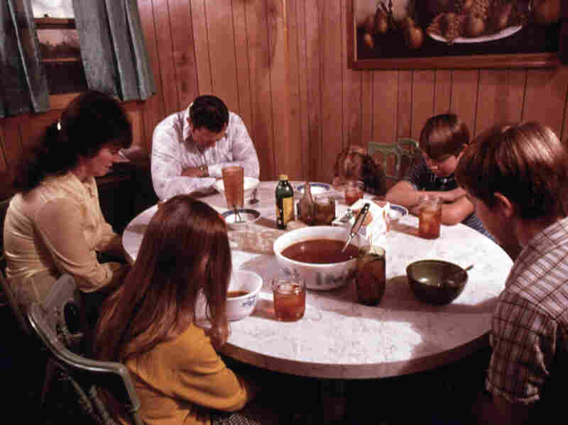 The Gipson family says a prayer before their evening meal in Chattanooga, Tenn.