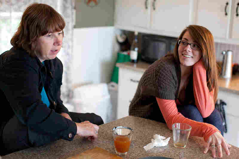 Sue Spencer and her daughter Gaelyn talk in their kitchen.