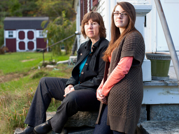 Sue Spencer, 50, sits with her daughter Gaelyn Spencer, 17, in front of their  home in Marlborough, N.H.