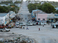 When bullets aren't flying, people are often on the streets of Mogadishu,  chatting and doing business. They are just trying to stay alive amid the violence.