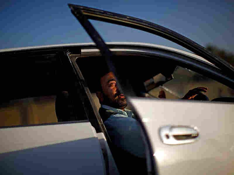 Sadiqullah, a taxi driver