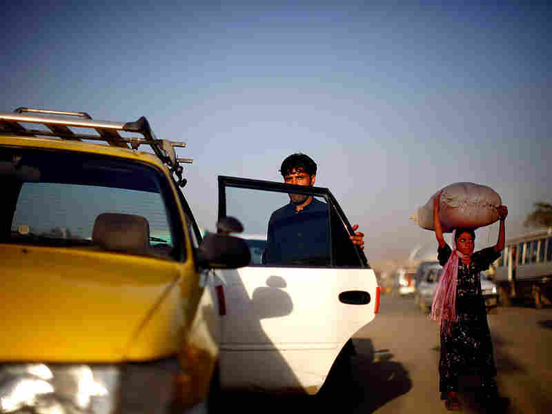 A taxi driver waits in Kabul