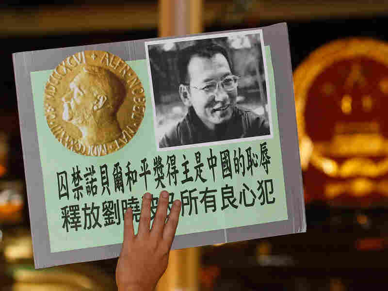 Pro-democracy protesters hold a picture of Chinese dissident Liu Xiaobo