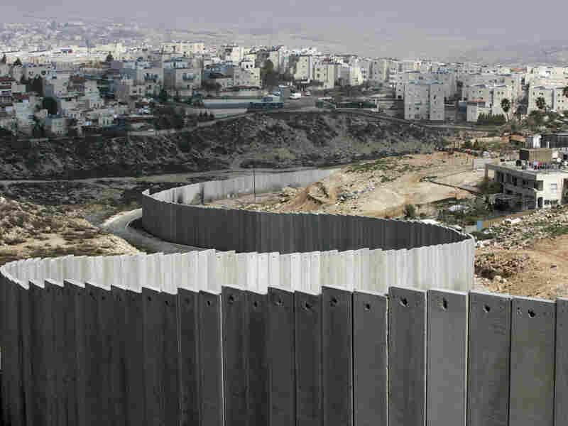 Israel's separation barrier sits in the east Jerusalem neighborhood of Ras Khamis