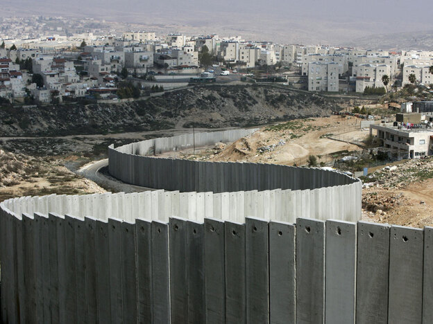 Israel's separation barrier is seen along the east Jerusalem neighborhood of Ras Khamis on March  4, 2009. Residents say the final portions were completed two weeks ago.