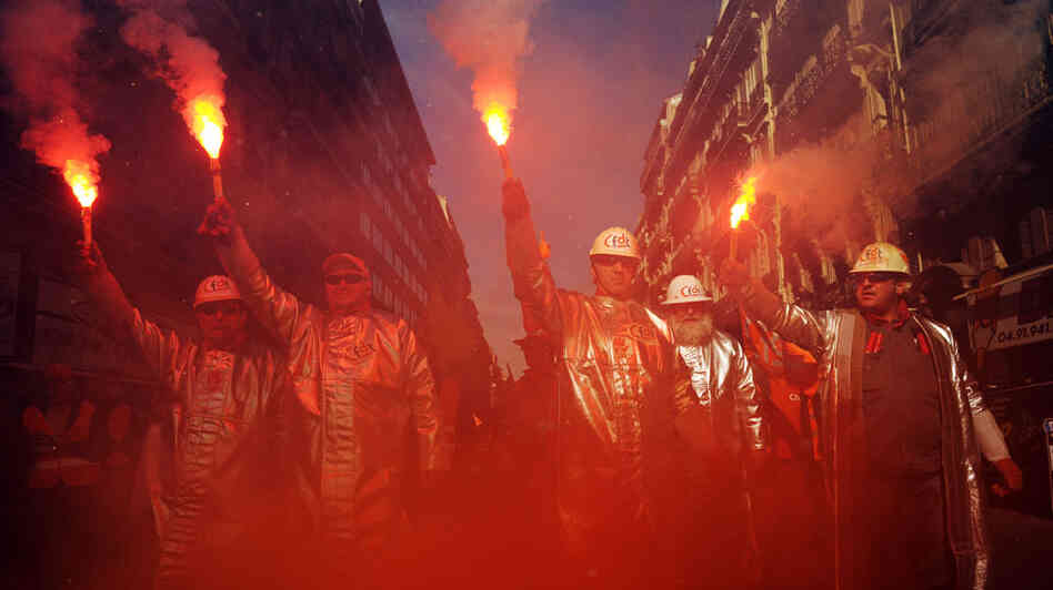 Metallurgists held flares as they marched in the southern port city of Marseille.