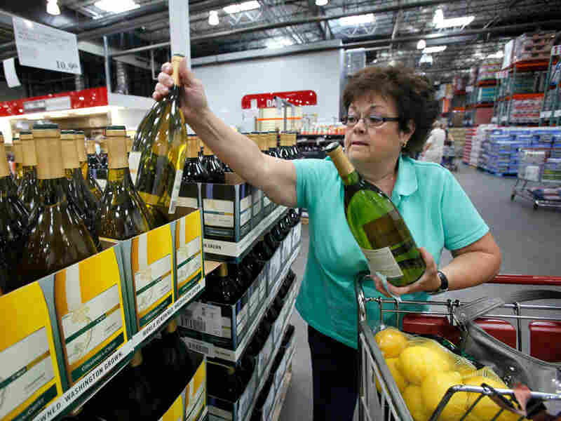 Georgia LaBelle reaches for a bottle of wine as she shops at a Costco warehouse store in Seattle.