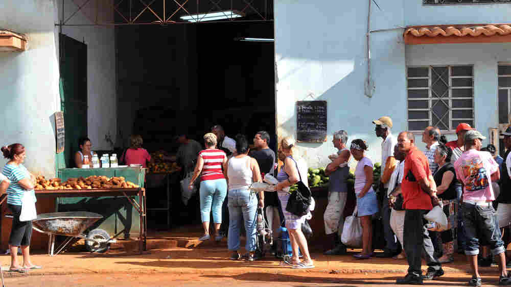 Cubans line up to buy potatoes in Havana in March 2010.