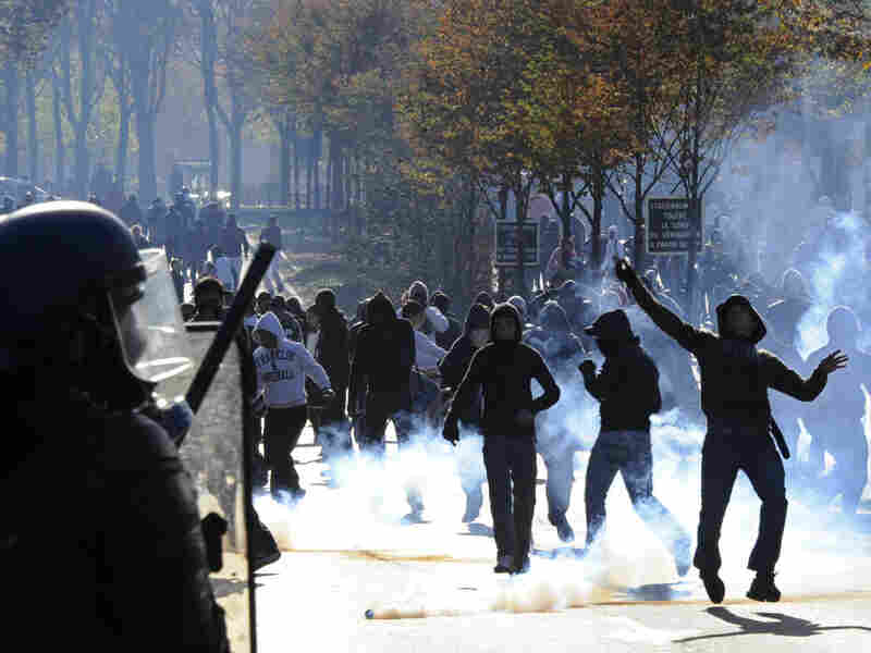 Youths hurled stones at anti-riot police in Nanterre, a western Paris suburb.