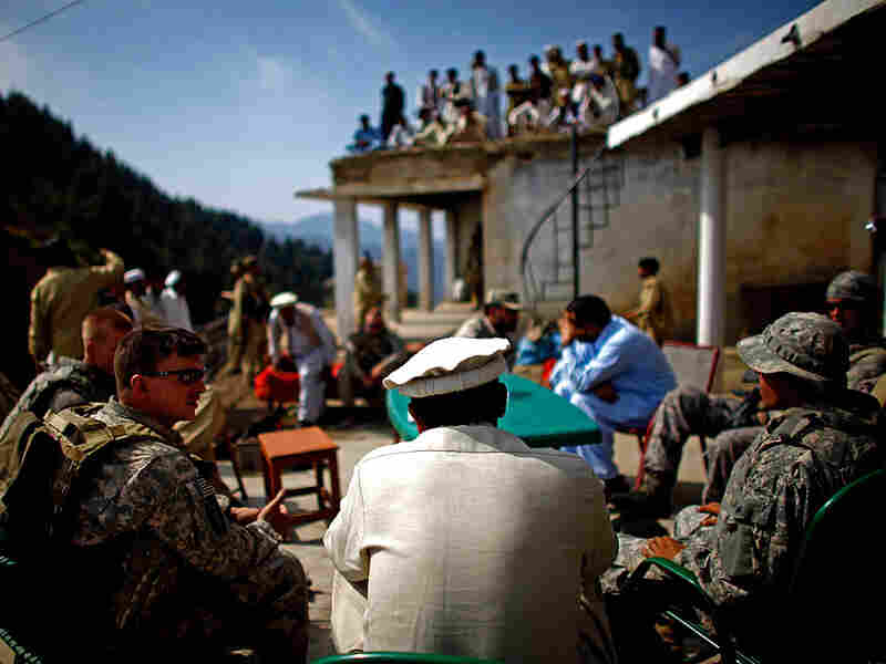 Army Capt. Thomas Billig shares a cup of tea and lunch with Pakistani Army Lt. Col. Ahmed Salim at the border