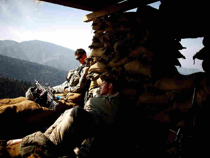 Soldiers with Alpha Company of the 101st Airborne Division get some much needed rest.