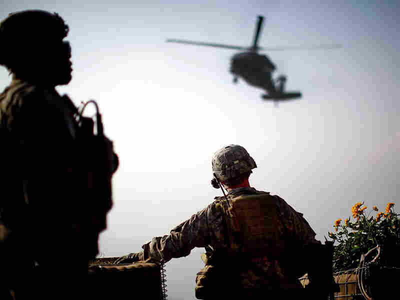 1st Sgt. Kenneth Bolin watches a resupply helicopter circle overhead