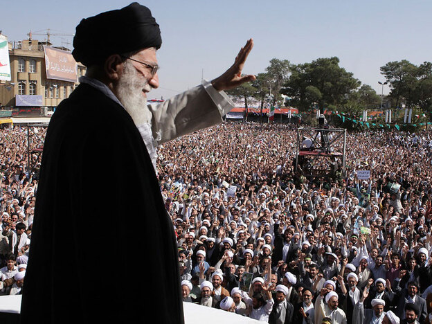 Iran's supreme leader, Ayatollah Ali Khamenei, waves to the crowd in a public gathering Tuesday during his visit to the city of Qom, 78 miles south of the capital Tehran. His trip is widely seen as an attempt to shore up his own status and legitimacy after last year's contentious presidential elections, in which he supported President Mahmoud Ahmadinejad.