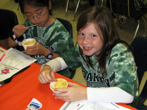 Third graders (from right) Kalli Cannistraro and Emily Park sample healthy food options at Oakton Elementary.