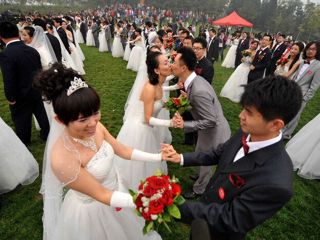 Despite China's advances over the past few decades, when it comes to marriage, tradition holds sway. Here, 200 newlywed couples pose at the National Stadium in Beijing, Oct. 10, 2010.