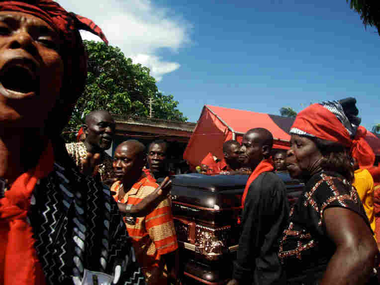 villagers from the Otuam fishing community carry the casket of their late ruler Nana Amuah-Afenyi.
