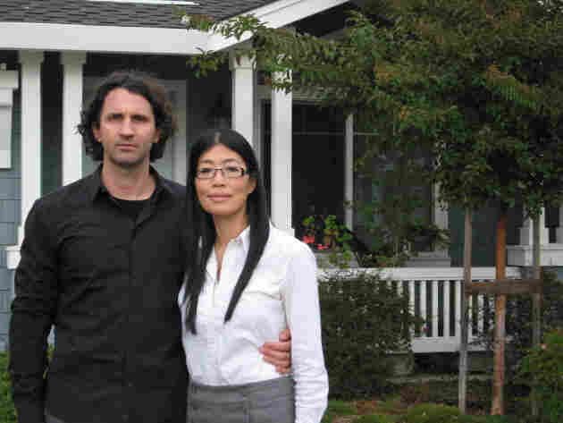 Grace Chen and her husband, Antonis Orphanou, stand outside their home in Mountain View, Calif.