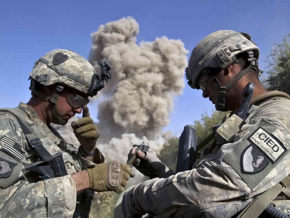U.S. soldiers explode an unused building they believe the Taliban may occupy.