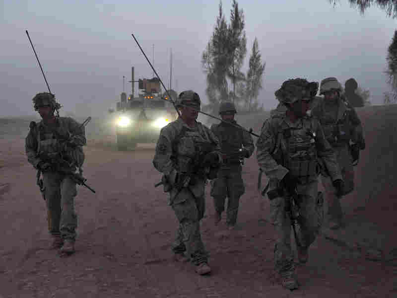 U.S. Army soldiers patrol a village in  Kandahar province.