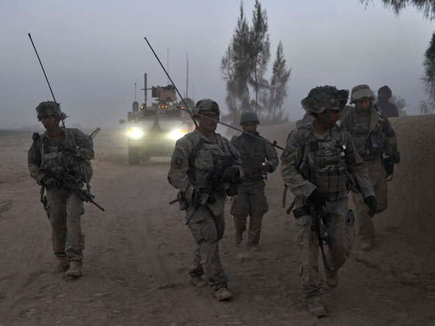 Army soldiers patrol a village in  Kandahar  province.
