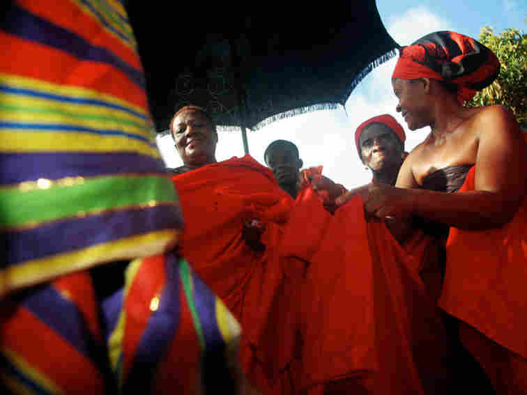 """During the traditional funeral ceremonies for her late uncle, """"King Peggy"""" is required to get up and dance."""