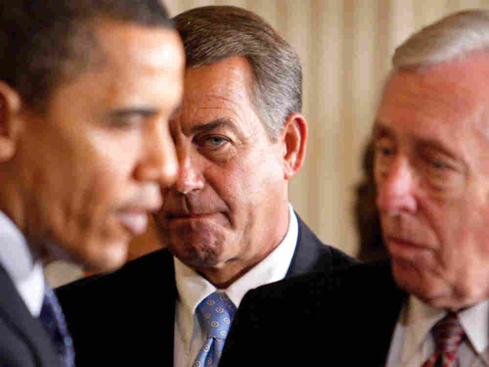 John Boehner looks on as President Obama talks to Steny Hoyer.