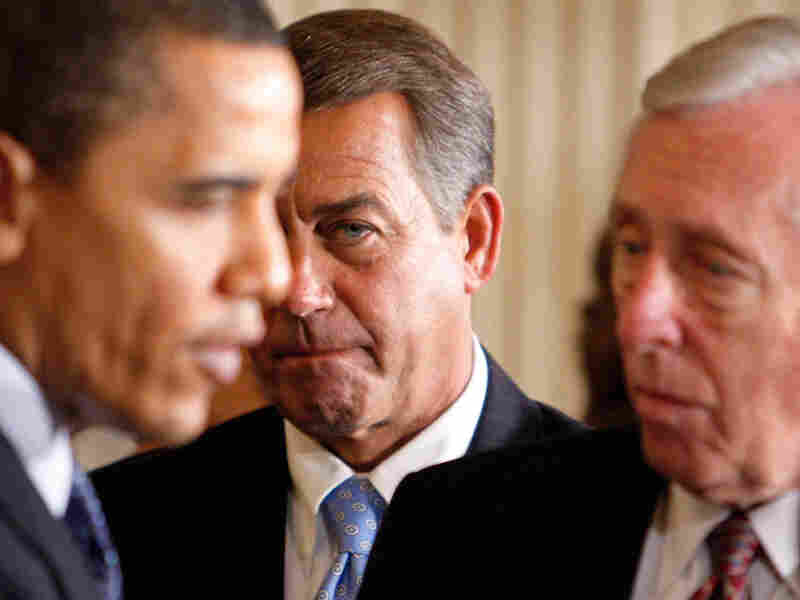 John Boehner looks on as President Obama talks to Steny Hoyer.