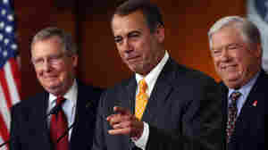 Rep. John Boehner, flanked by Sen. Mitch McConnell and Mississippi Gov. Haley Barbour.