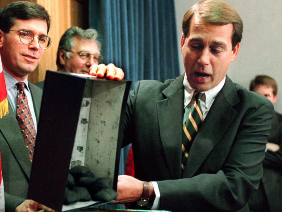 Boehner dumps out the coal that he  called a Christmas gift to President Clinton during a news  conference to discuss the federal budget in 1995. When Newt Gingrich became House speaker that year, he took Boehner into the inner circle of GOP leaders.