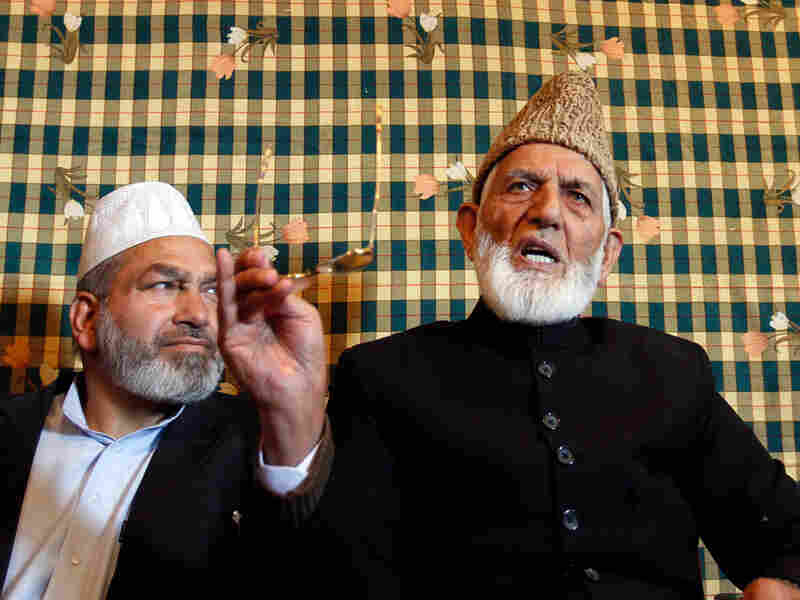 Kashmiri separatist leader Syed Ali Shah Geelani, right