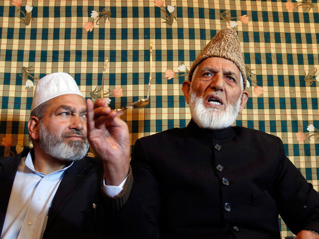 Kashmiri  separatist leader Syed Ali Shah Geelani (right) addresses a press conference at  his party headquarters in Srinagar on Oct. 25. Geelani, who is under house arrest, has refused to speak with a team of Indian negotiators dispatched to revive Kashmir talks.