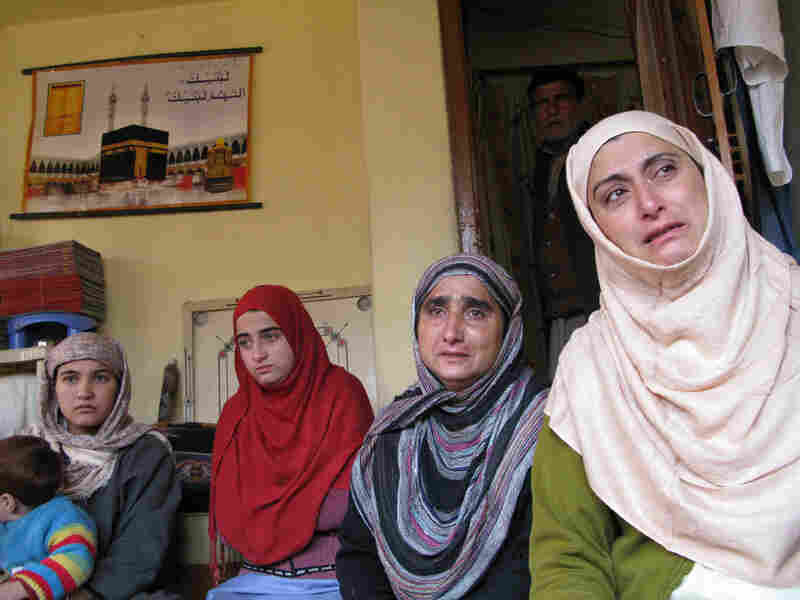 Relatives mourn the death of Mudasir Ahmed Kachroo, a Kashmiri man fatally shot by Indian security forces
