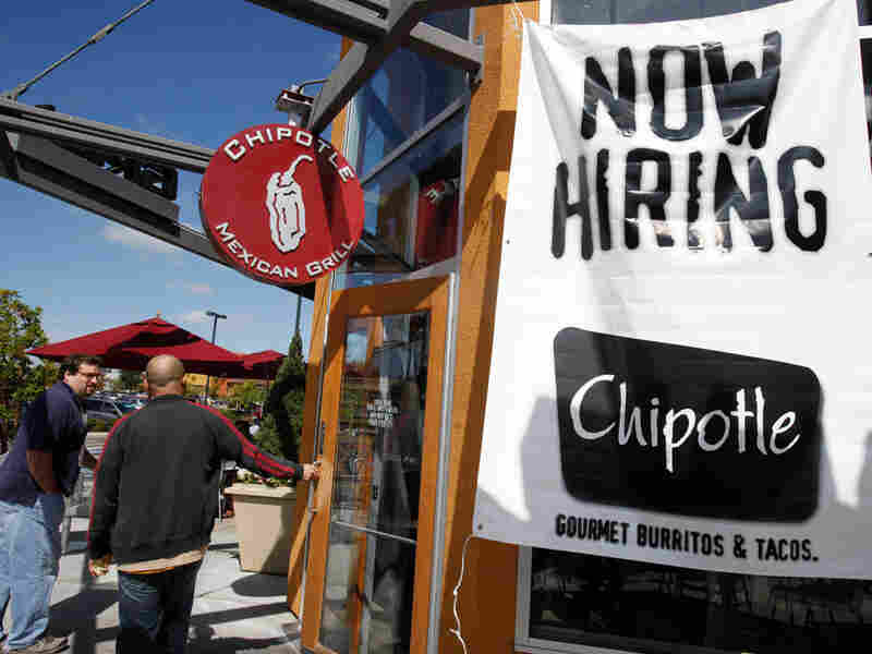 Customers walk into a Chipotle restaurant, in Mountain View, Calif.